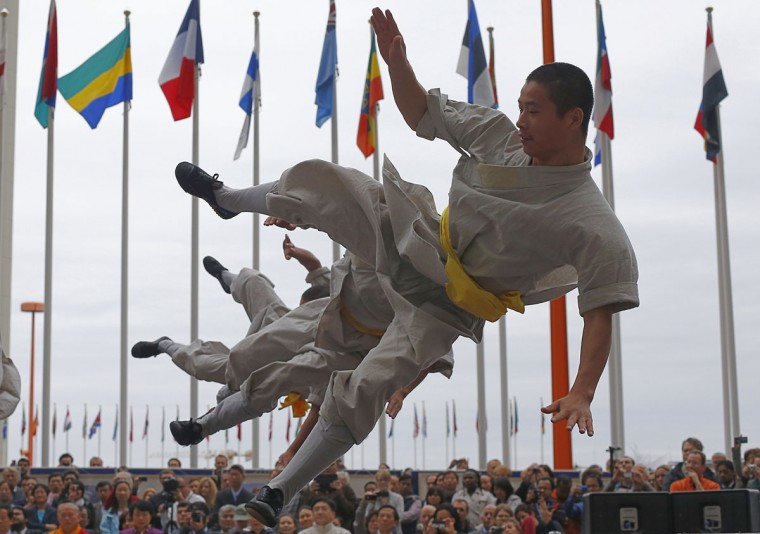 Chinese shaolin monks perform shaolin kung fu martial arts as part of a martial art exhibition at the UN headquarters in Vienna. (Alexander Klein/AFP/Getty Images)