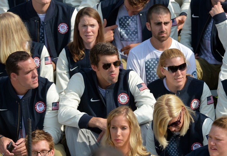 U.S. swimmer Michael Phelps and other Olympians wait for U.S. President Barack Obama and first lady Michelle Obama to arrive for a ceremony at the White House. (Jewel Samad/AFP/Getty Images)