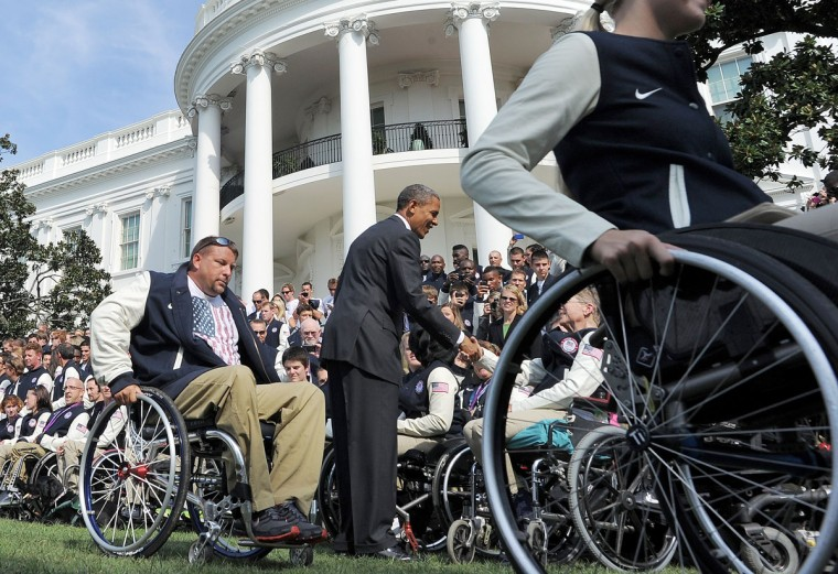 U.S. President Barack Obama greets Olympic and Paralympic athletes on the south lawn of the White House. (Jewel Samad/AFP/Getty Images)