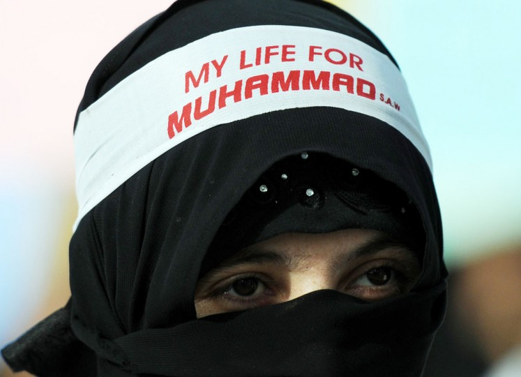 A veiled Pakistani Muslim woman takes part an anti-US protest rally against an American produced film mocking Islam on September 16, 2012 in Karachi. (Asif Hassan/AFP/Getty Images)