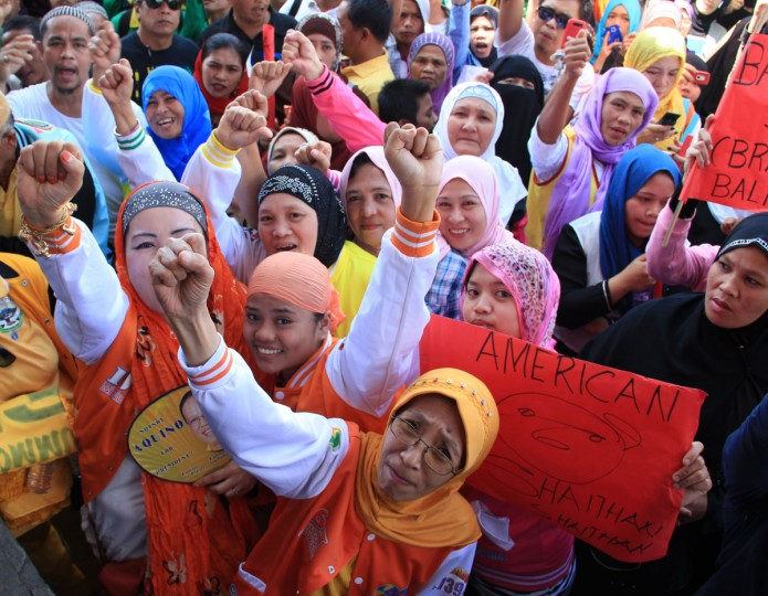 Philippine Muslims raise clinched fists as they wave placards with anti-U.S. and Israeli slogans during a protest against an anti-Islam film, in Marawi City, Lanao del sur province, in southern island of Mindanao on September 17, 2012. (Richel Umel/AFP/Getty Images)