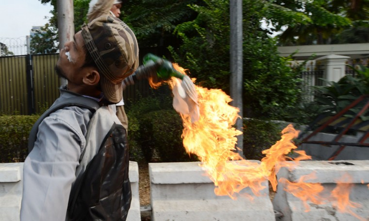 An Indonesian protester hurls a molotov coctail towards the U.S. embassy during a protest against a low-budget film insulting to Muslims in Jakarta on September 17, 2012. (Adek Berry/AFP/Getty Images)