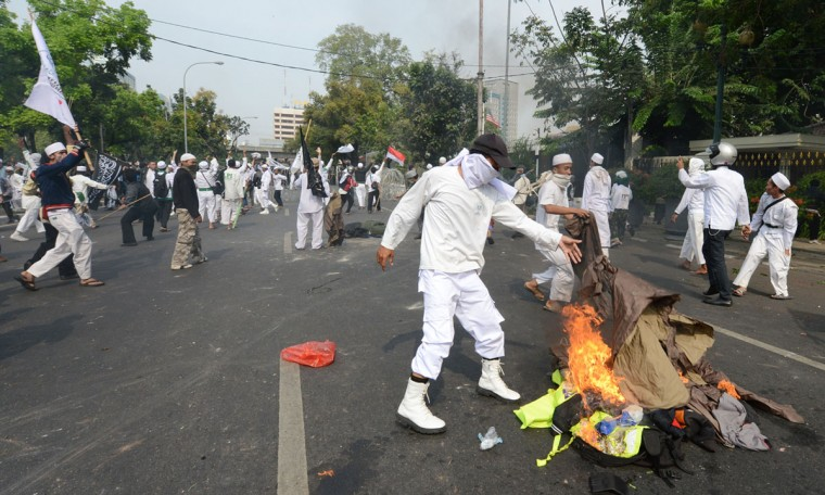 Indonesian protesters burn polices property during a protest against a low-budget film insulting to Muslims outside the U.S. embassy in Jakarta on September 17, 2012. (Adek Berry/AFP/Getty Images)