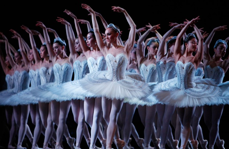 "Dancers from the Australian Ballet perform a new traditional production of ""Swan Lake"" by choreographer Stephen Baynes in Melbourne on September 17, 2012. The new production of Swan Lake, which was the first ever ballet performed by the Australian Ballet in 1962, will have its world premiere production on September 18 before heading to Sydney on November 30 as the company celebrate's its 50th birthday. (Caroline Pankert/AFP/Getty Images)"