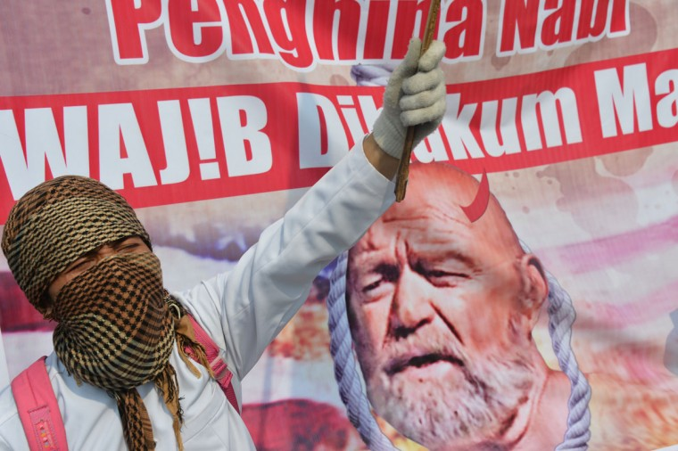 An Indonesian Muslim protester shouts slogans during a protest against a low-budget film insulting to Muslims outside the U.S. embassy in Jakarta on September 17, 2012. Protesters hurled petrol bombs and clashed with Indonesian police outside the U.S. Embassy in Jakarta on September 17, as demonstrations in the world's most populous Muslim nation turned violent. (Adek Berry/AFP/Getty Images)