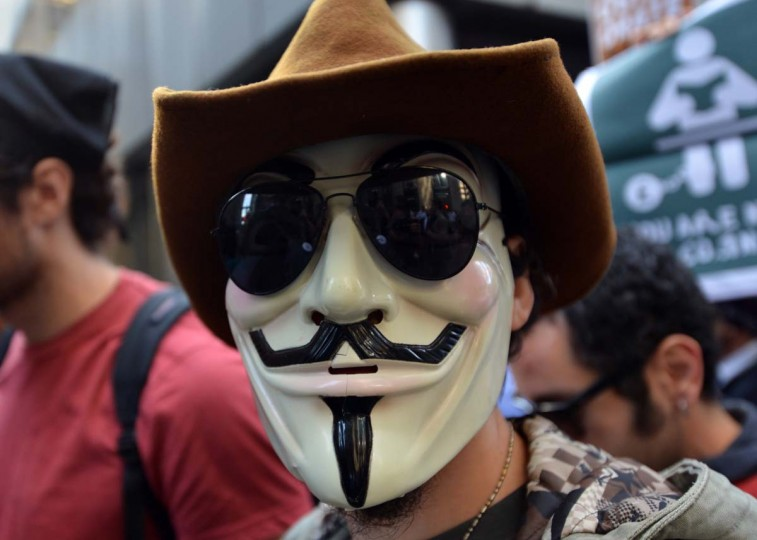 Occupy Wall Street protester with a mask and sunglasses on the one year anniversary of the movement in New York. Police in New York on Monday arrested at least a dozen demonstrators marking the one-year anniversary of the Occupy Wall Street movement, witnesses said. (Stan Honda/Getty Images)