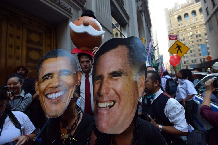 Occupy Wall Street protesters wearing President Barack Obama and Mitt Romney masks march near Wall Street on the one year anniversary of the movement in New York. (Stan Honda/Getty Images)