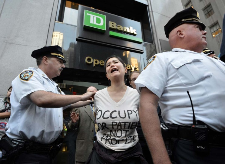 A woman is arrested during the Occupy Wall Street protest on the one year anniversary of the movement in New York. Police in New York on Monday arrested at least a dozen demonstrators marking the one-year anniversary of the Occupy Wall Street movement, witnesses said. (Stan Honda/Getty Images)