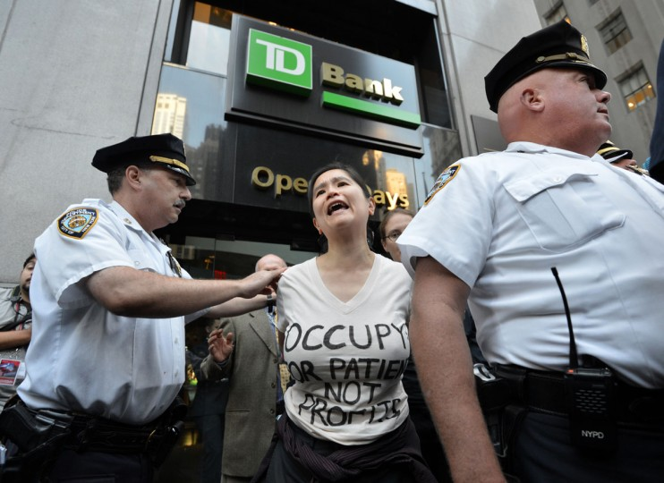 A woman is arrested during the Occupy Wall Street protest September 17, 2012 on the one year anniversary of the movement in New York. Police in New York on Monday arrested at least a dozen demonstrators marking the one-year anniversary of the Occupy Wall Street movement, witnesses said. (Stan Honda/AFP/Getty Images)