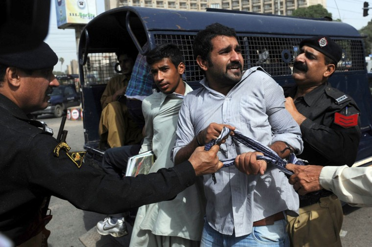 Pakistani policemen arrest activists from Islami Jamiat-e-Talaba, a student wing of the hardline Sunni party Jamaat-e-Islami (JI), near the U.S. consulate during a protest against an anti-Islam movie in Karachi on September 17, 2012. (Rizwan Tabassum/AFP/Getty Images)