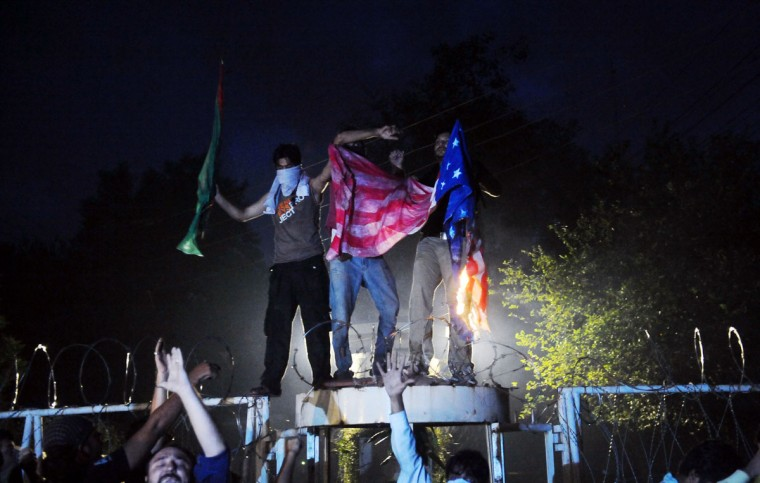 Pakistani Shiite Muslims torch a U.S. flag in front of the U.S. consulate building during a protest against an anti-Islam movie in Lahore on September 17, 2012. (Arif Ali/AFP/Getty Images)