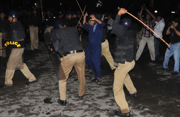 Pakistani policemen baton charge Shiite Muslims protesters in front of the U.S. consulate building during a rally against an anti-Islam movie in Lahore on September 17, 2012. (Arif Ali/AFP/Getty Images)