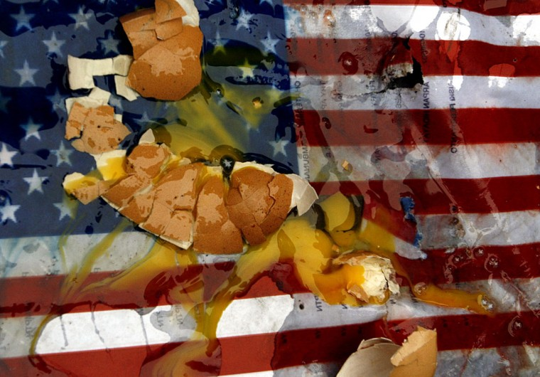 U.S. flag printed on paper is pictured after Indonesian protesters threw eggs onto it during a rally outside the U.S. diplomatic mission in Medan on September 17, 2012. About 50 students trampled on the American flag and threw eggs at a U.S. diplomatic mission in the city of Medan, capital of North Sumatra province, an AFP reporter at the scene said. (Atar Atar/AFP/Getty Images)