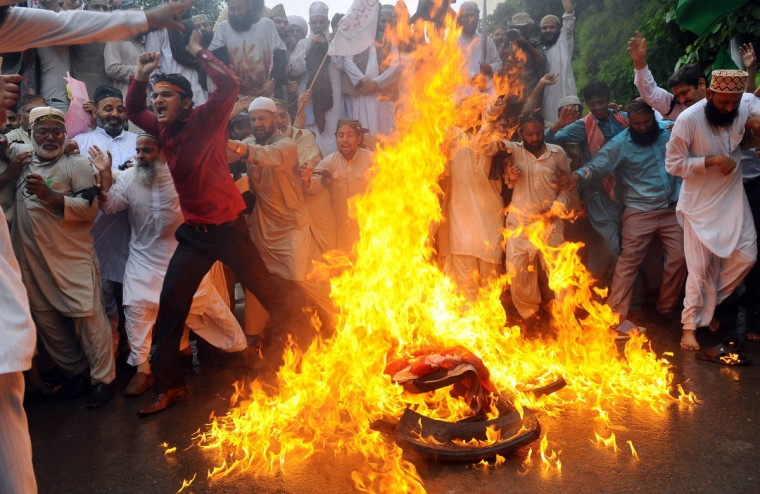 Pakistani Sunni Muslims torch a U.S. flag during a protest against an anti-Islam movie in Lahore on September 17, 2012. (Arif Ali/AFP/Getty Images)