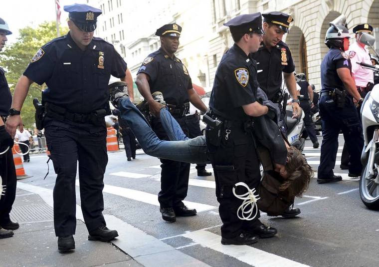 An participant in Occupy Wall Street protest is arrested by police during a rally to mark the one year anniversary of the movement in New York. (Emmanuel Dunand/AFP/Getty Images)