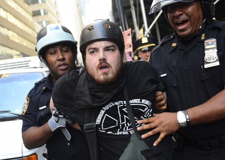 A participant in Occupy Wall Street protest is arrested by police during a rally to mark the one year anniversary of the movement in New York. (Emmanuel Dunand/AFP/Getty Images)