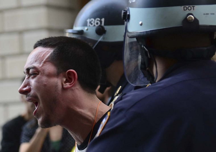 A participant in Occupy Wall Street protest is arrested by police during a rally to mark the one year anniversary of the movement in New York. Police in New York on Monday arrested at least a dozen demonstrators marking the one-year anniversary of the Occupy Wall Street movement,(Emmanuel Dunand/AFP/Getty Images)