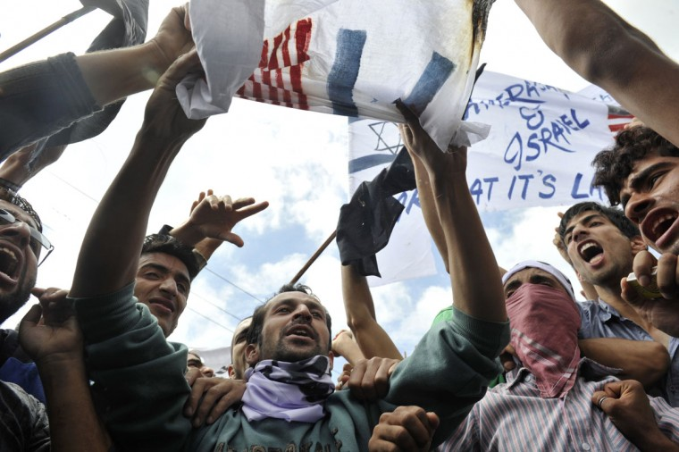 Kashmiri Muslims shout anti-U.S. and Israeli slogans during a protest and one day strike called by several religious and political organisations to protest an anti-Islam movie in Srinagar on September 18, 2012. (Tauseef Mustafa/AFP/Getty Images)