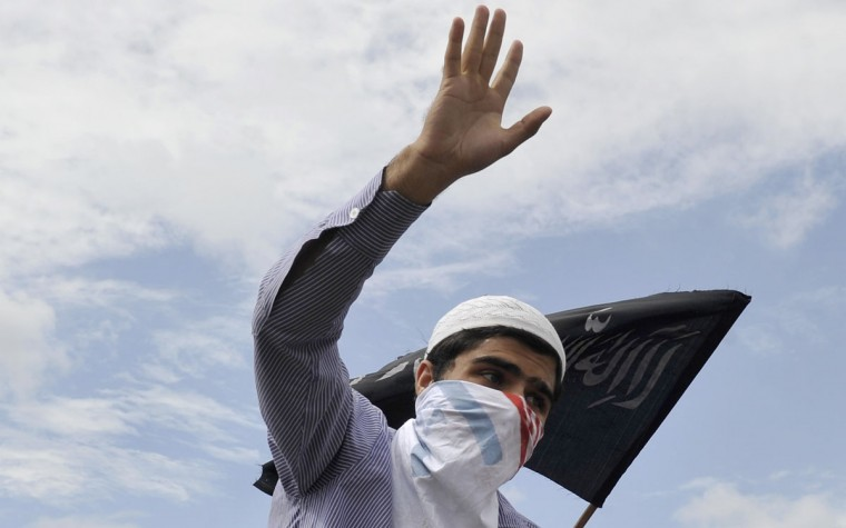 Kashmiri Muslims shout anti-US and Israeli slogans during a protest and one day strike called by several religious and political organisations to protest an anti-Islam movie in Srinagar on September 18, 2012. (Tauseef Mustafa/AFP/Getty Images)