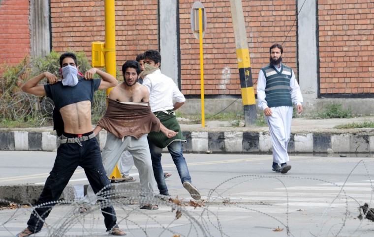 Kashmiri muslim protestors clash with Indian police during a protest and one day strike called by several religious and political organisations to protest an anti-Islam movie in Srinagar on September 18, 2012. (Rouf Bhat/AFP/Getty Images)