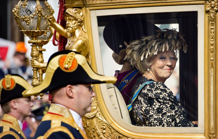 Queen Beatrix of The Netherlands looks on from the Golden Carriage as she leaves Noordeinde Palace for a ride to the Ridderzaal in The Hague on Prince's Day (Prinsjesdag), the presentation of the coming financial year. (Koen van Weel/AFP/Getty Images)