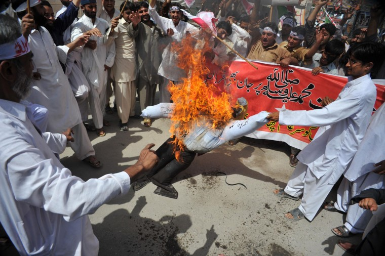 Pakistani activists of the hard line Sunni party Jamaat-e-Islami (JI) burn an effigy of U.S. President Barack Obama during a protest against an anti-Islam movie in Peshawar on September 18, 2012. (A. Majeed/AFP/Getty Images)