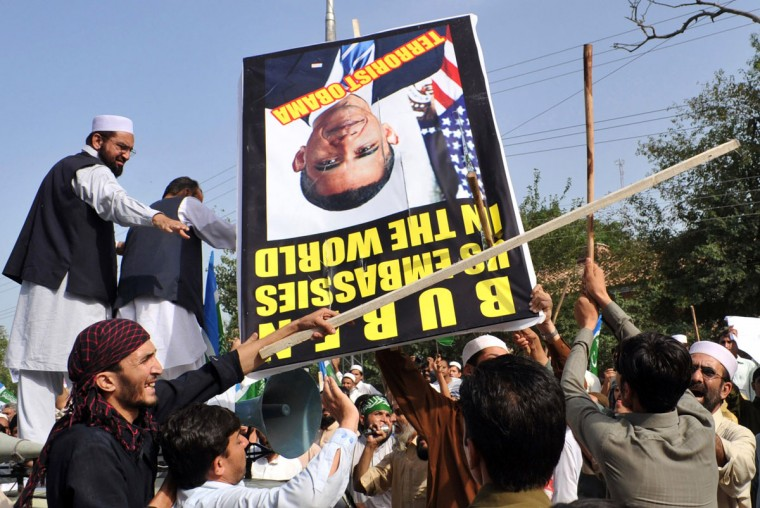 Pakistani activists of the hard line Sunni party Jamaat-e-Islami (JI) beat a protrait of US President Barack Obama during a protest against an anti-Islam movie in Peshawar on September 18, 2012. (A. Majeed/AFP/Getty Images)
