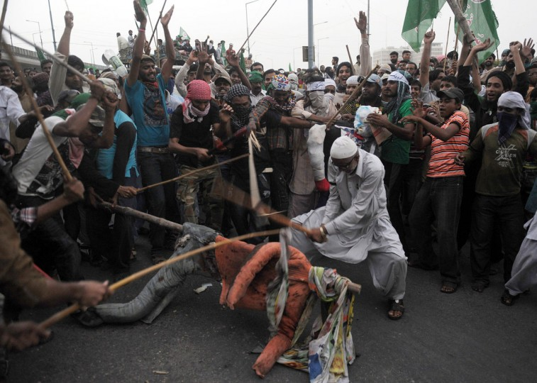 Pakistani Sunni Muslims protesters beat an effigy of the U.S. President Barack Obama during a protest against an anti-Islam movie in Peshawar on September 18, 2012. (Rizwan Tabassum/AFP/Getty Images)