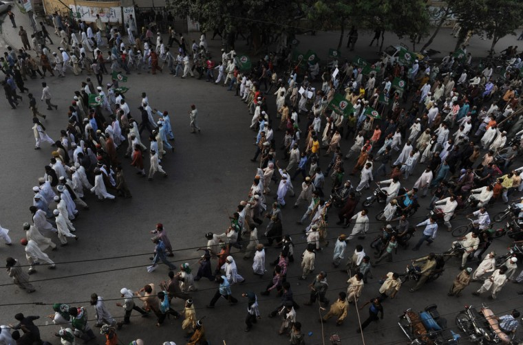 Pakistani Sunni Muslims march during a protest against an anti-Islam movie in Peshawar on September 18, 2012. Police used tear gas to disperse a crowd of more than 2,000 protesters trying to reach the U.S. consulate in northwest Pakistan as fresh demonstrations erupted against an anti-Islam film. (Rizwan Tabassum/AFP/Getty Images)