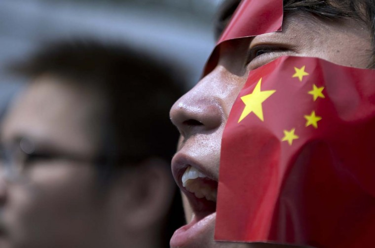 """A Chinese national living in Malaysia shouts wears stickers of the Chinese national flag on his face as he shouts slogans during a protest against Japan's """"nationalizing"""" of disputed islands known as Diaoyu in Chinese and as Senkaku in Japan, in front of the Japanese embassy in Kuala Lumpur. The islands are controlled by Japan but claimed by China and Taiwan, and the current row has roiled the political relationship between Beijing and Tokyo. (Saeed Khan/AFP/Getty Images)"""