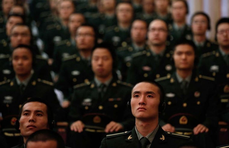 Cadets listen to a speech by US Defense Secretary Leon Panetta at the People's Liberation Army (PLA) Engineering Academy of Armored Forces in Beijing. Panetta sought to reassure Beijing over Washington's strategic tilt to the Pacific, telling a military audience it was not an attempt to curb Chinese power. (Larry Downing/Getty Images)