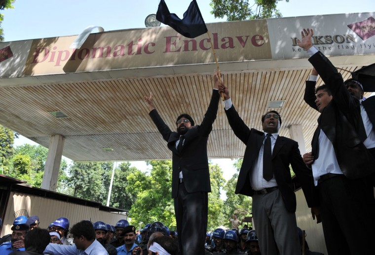 Pakistani lawyers shout anti-U.S. slogans as they attempt to reach the U.S. embassy in the diplomatic enclave during a protest against an anti-Islam movie in Islamabad on September 19, 2012. Up to 500 Pakistani lawyers managed to enter the heavily guarded diplomatic enclave in a fresh wave of protests that erupted across Pakistan to denounce an anti-Islam film. (Aamir Qureshi/AFP/Getty Images)