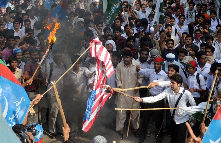 Pakistani activists of the hard line Sunni party Jamaat-e-Islami (JI) burn a US flag during a protest against an anti-Islam movie in Lahore on September 19, 2012. The Pakistan government has declared Friday a national holiday in honor of the Muslim prophet Mohammed and called for peaceful protests against a U.S.-made film deemed insulting to Islam. (Arif Ali/AFP/Getty Images)