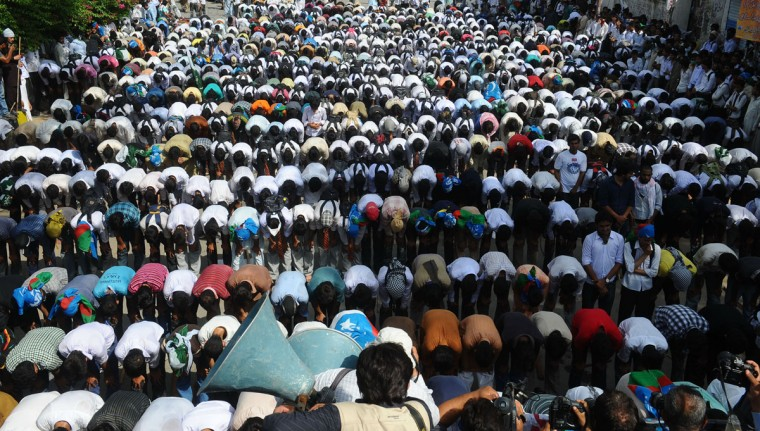 Pakistani activists of the hard line Sunni party Jamaat-e-Islami (JI) offer prayers near the US consulate during a protest against an anti-Islam movie in Lahore on September 19, 2012. The Pakistan government has declared Friday a national holiday in honor of the Muslim prophet Mohammed and called for peaceful protests against a U.S.-made film deemed insulting to Islam. (Arif Ali/AFP/Getty Images)