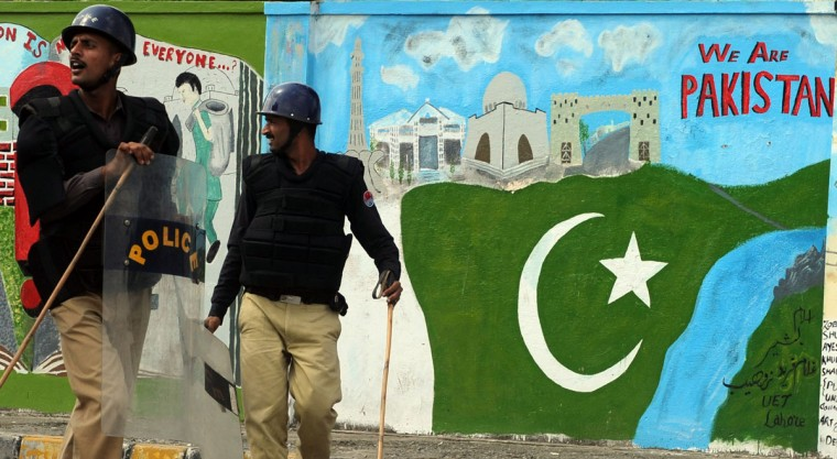 Pakistani riot policemen stand guard during a protest rally organised by the hard line Sunni party Jamaat-e-Islami (JI) near the U.S. consulate against an anti-Islam movie in Lahore on September 19, 2012. The Pakistan government has declared Friday a national holiday in honor of the Muslim prophet Mohammed and called for peaceful protests against a U.S.-made film deemed insulting to Islam. (Arif Ali/AFP/Getty Images)