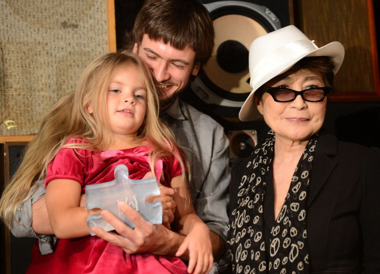 "Artist Yoko Ono presents the ""LennonOno Grant for Peace"" to Pyotr Verzilov (C) and 4-year old Gera, husband and daughter of Nadia Tolokonnikova, one of the three imprisoned Pussy Riot members in New York. The presentation took place ahead of an October 1, 2012 hearing that will determine the fate of the three Pussy Riot Russian music band members, sentenced to two years in prison for performing a protest song in a Moscow's cathedral. (Emmanuel Dunand/AFP/Getty Images)"