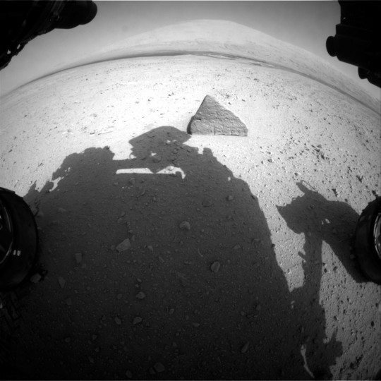 September 21, 2012: This image was taken by Front Hazcam: Left A on board NASA's Mars rover Curiosity on Sol 45 of a rock. Curiosity sends back raw images for current and prior Sols based on commands sent by the mission team. The rover uses orbiters to relay back a lot of its data and maximizes each opportunity when they pass by overhead. (NASA/JPL-Caltech/HO/AFP/Getty Images)