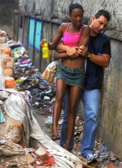 A crack addict is caught by a member of the municipal Social Assistence department of Rio de Janeiro, during an operation at the Madureira area, 25 Km from Rio's downtown. (Antonio Scorza/AFP/Getty Images)