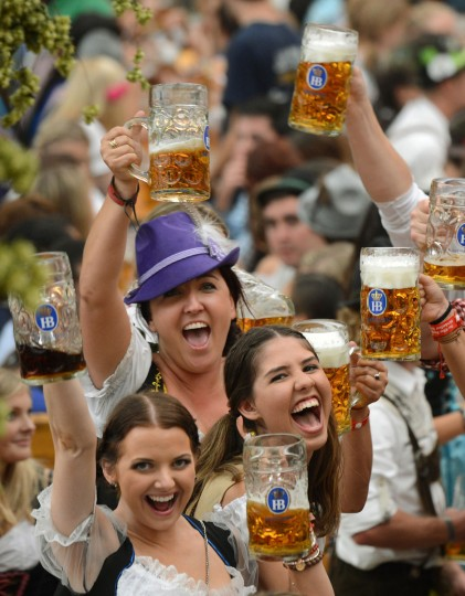 Visitors wearing traditional Bavarian clothes get the first beers in a festival tent at the start of the Oktoberfest beer festival in Munich, Germany. (Christof Stache/AFP/Getty Images)