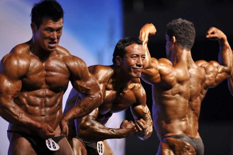 This picture taken on September 23, 2012, shows competitors posing during the 46th Asian Bodybuilding and Physique Sports Championships in Guangzhou, in southern China's Guangdong province. Over 200 athletes from more than 20 Asian countries signed up for the games, and champions from other competitions also joined in to show off their muscles. (Stringer/AFP/Getty Images)