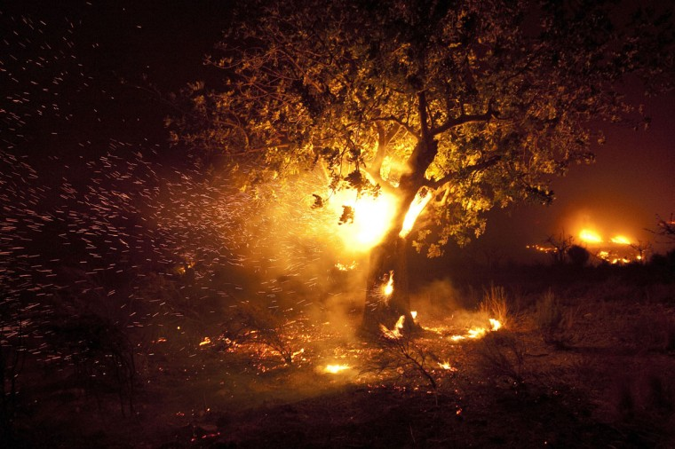 A picture taken early on September 24, 2012 shows a fire blazing in a forest near the city of Domeno, near Valencia. (Jose Jordan/AFP/Getty Images)