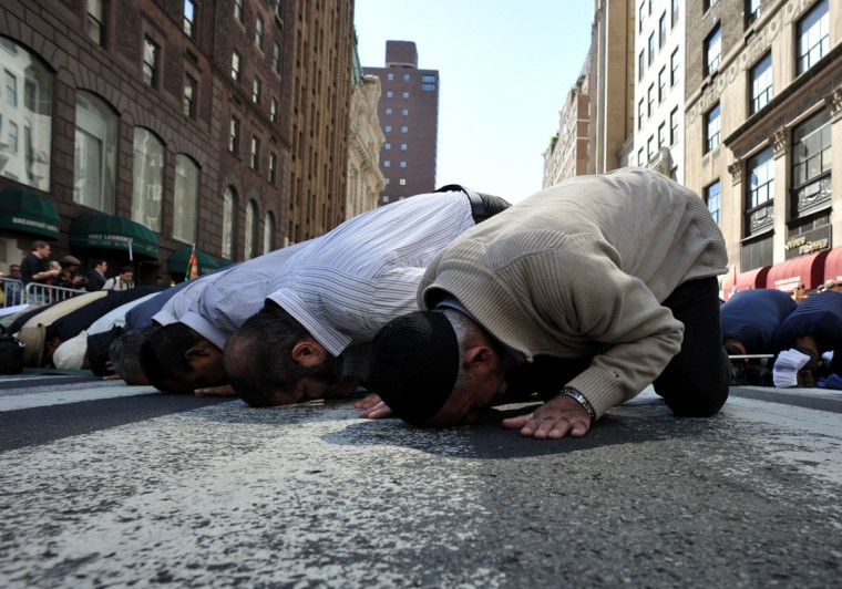 Men pray on Madison Avenue just before the 27th annual Muslim Day Parade on September 23, 2012 in New York. (Stan Honda/AFP/Getty Images)