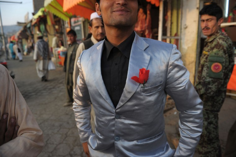 Sunil, a young Afghan boxer strikes a pose as he shows off his suit in a street in downtown Kabul on September 24, 2012. Sunil who asked for his photo to be taken said he was wearing his best suit because he knew he would be seen by his friends who would congratulate him for winning an amateur fight the night before. (Roberto Schmidt/AFP/Getty Images)