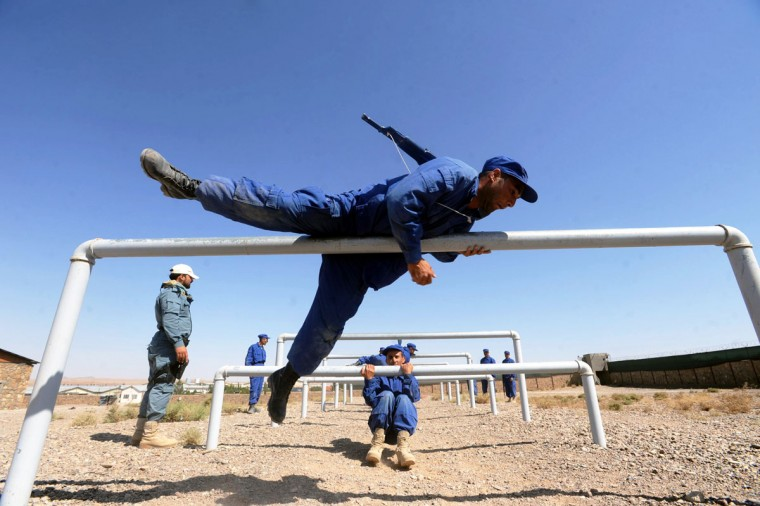 Afghan police cadets run drills during a training exercise at a police academy outside Herat on September 24, 2012. The cadets have to complete an 8 week course before graduating. (Aref Karimi/AFP/Getty Images)