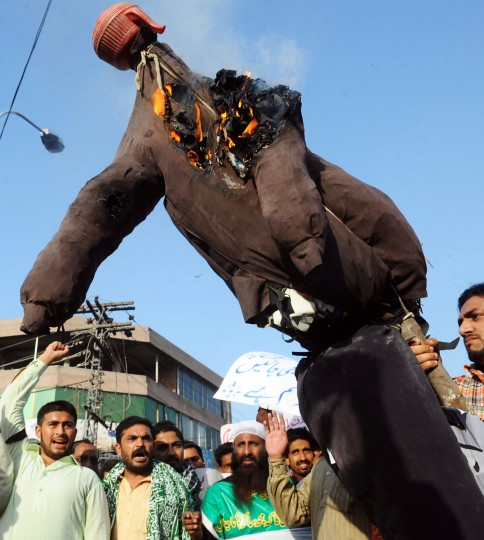 A Pakistani demonstrator holds a burning effigy of Florida pastor Terry Jones during a protest against an anti-Islam film in Lahore on September 24, 2012. More than 50 people have died around the world in violence linked to the low-budget movie, which mocks Islam and the Prophet Mohammed, since the first demonstrations erupted on September 11. (Arif Ali/AFP/Getty Images)