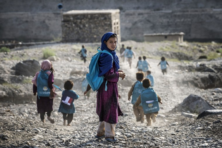 Afghan children run to school on September 24, 2012, in a village on the road to Naghlu the French army base. France is the fifth largest contributor to NATO's International Security Assistance Force (ISAF), which is due to pull out the vast majority of its 130,000 troops by the end of 2014. (Jeff Pachoud/AFP/Getty Images)