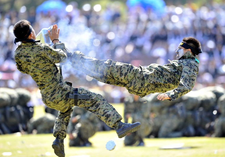 South Korean Special Army soldiers perform martial arts during a ceremony to mark the 64th Korea Armed Forces Day at the military headquarters in Gyeryong, about 140 km south of Seoul. The two Koreas remain technically at war since the Korean conflict was concluded with a truce rather than a peace treaty, and small border incidents in the past have been known to escalate swiftly. (Jung Yeon-Je/AFP/Getty Images)