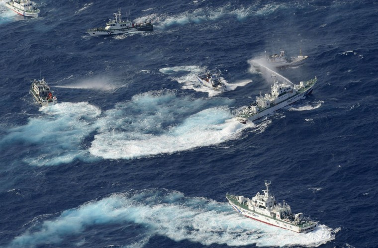 A Japan Coast Guard vessel (R) sprays water against Taiwanese fishing boats, while a Taiwanese coast guard ship (L) also sprays water in the East China Sea near Senkaku islands as known in Japanese or Diaoyu Islands in Chinese. Coastguard vessels from Japan and Taiwan dueled with water cannon after dozens of Taiwanese boats escorted by patrol ships sailed into waters around the Tokyo-controlled islands. (Yomiuri Shimbun/AFP/Getty Images)
