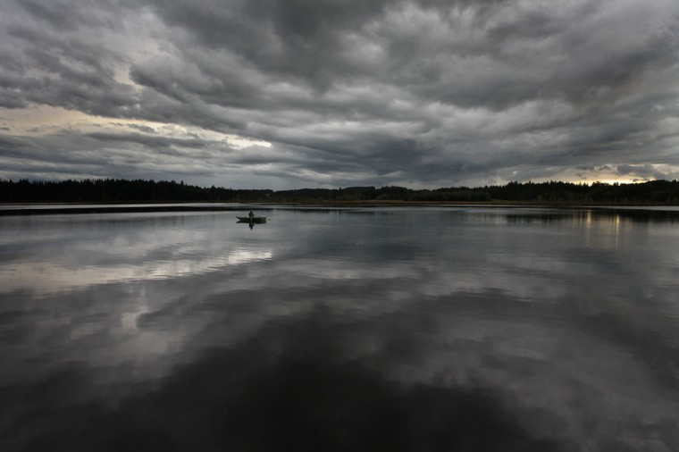 Dark clouds reflect in the water of the Elbsee lake near Aitrang, southern Germany, on September 24, 2012. Meteorologists forecast sinking temperatures and cloudy sky for the coming days in Bavaria. (Karl-Josef Hildenbrand/AFP/Getty Images)