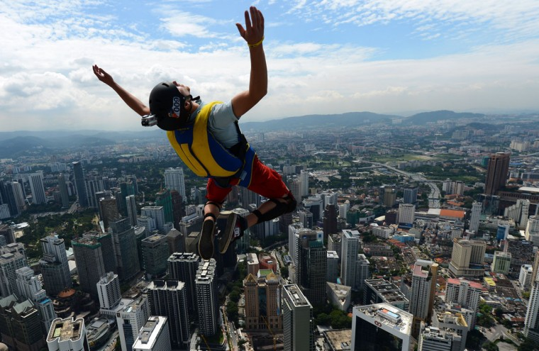 Base jumper Anton Chervyakov from Russia leaps from the top of the 421-meter Kuala Lumpur Tower during the International Tower Jump in Kuala Lumpur on September 27, 2012. Some 95 professional basejumpers from 18 countries are taking part in the annual event. (Mohd Rasfan/AFP/Getty Images)